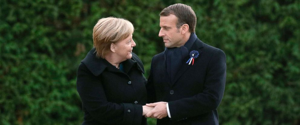 PHOTO: German Chancellor Angela Merkel and French President Emmanuel Macron hold hands after unveiling a plaque in a French-German ceremony in the clearing of Rethondes (the Glade of the Armistice) in Compiegne, northern France, Nov. 10, 2018.