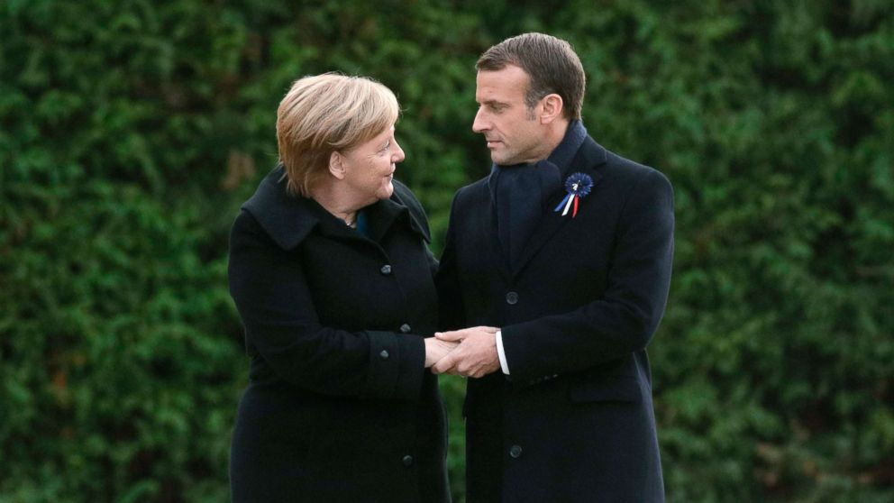 German Chancellor Angela Merkel and French President Emmanuel Macron hold hands after unveiling a plaque in a French-German ceremony in the clearing of Rethondes (the Glade of the Armistice) in Compiegne, northern France, Nov. 10, 2018, as part of commemorations marking the 100th anniversary of the 11 November 1918 armistice, ending World War I.