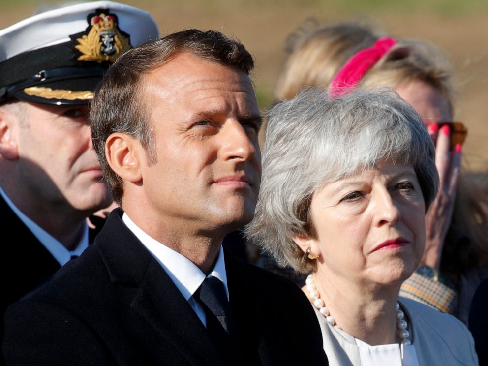 PHOTO: British Prime Minister Theresa May and French President Emmanuel Macron attend a Franco-British ceremony to mark the 75th anniversary of D-Day landings.