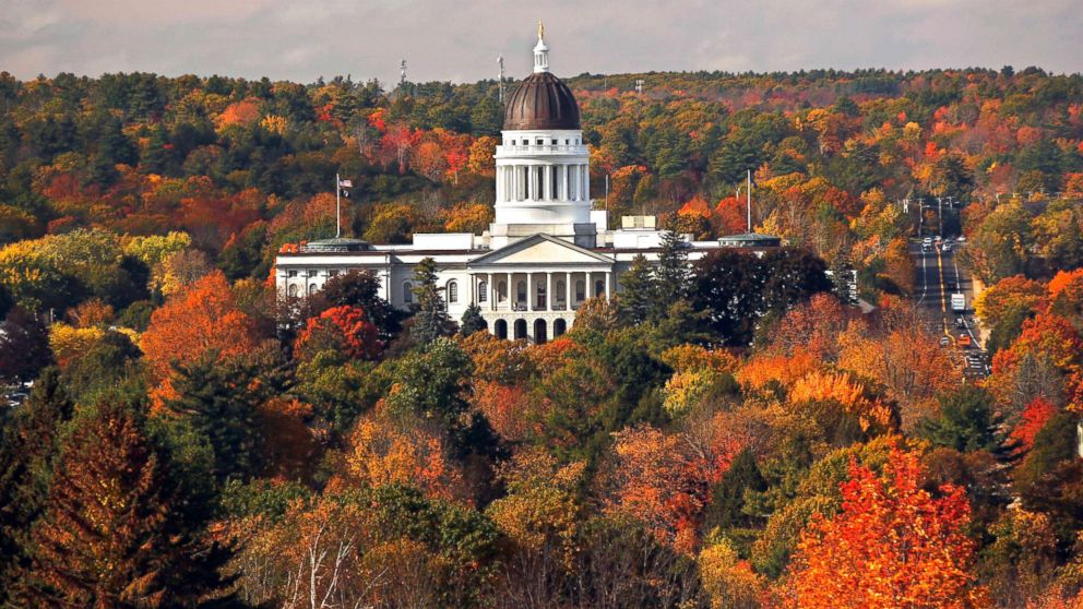 The State House is surrounded by fall foliage, Oct. 23, 2017, in Augusta, Maine.
