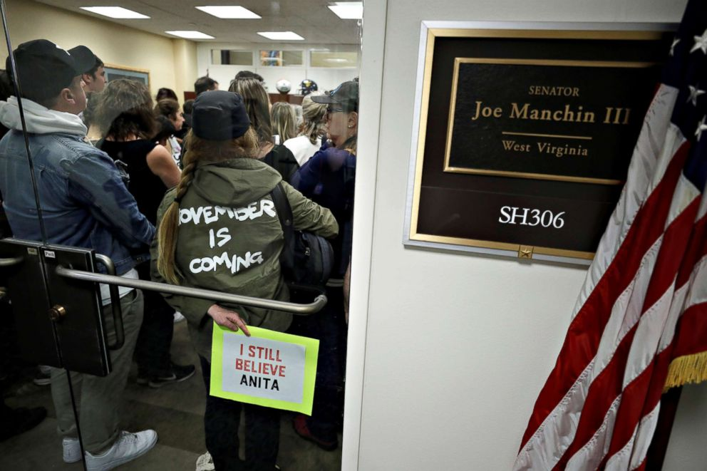PHOTO: Demonstrators gather in the office of Sen. Joe Manchin (D-WV) following a procedural vote in the Senate on the confirmation of U.S. Supreme Court nominee Judge Brett Kavanaugh on Capitol Hill in Washington, Oct. 5, 2018.