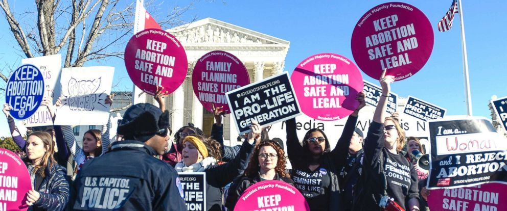 PHOTO: Abortion rights and anti-abortion rights advocates protest in front of the U.S. Supreme Court during the 2018 March for Life on Jan. 19, 2018, in Washington, D.C.