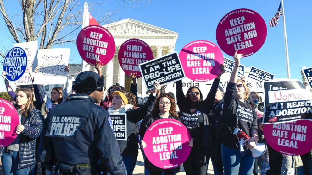 Abortion rights and anti-abortion rights advocates protest in front of the U.S. Supreme Court during the 2018 March for Life on Jan. 19, 2018, in Washington, D.C.