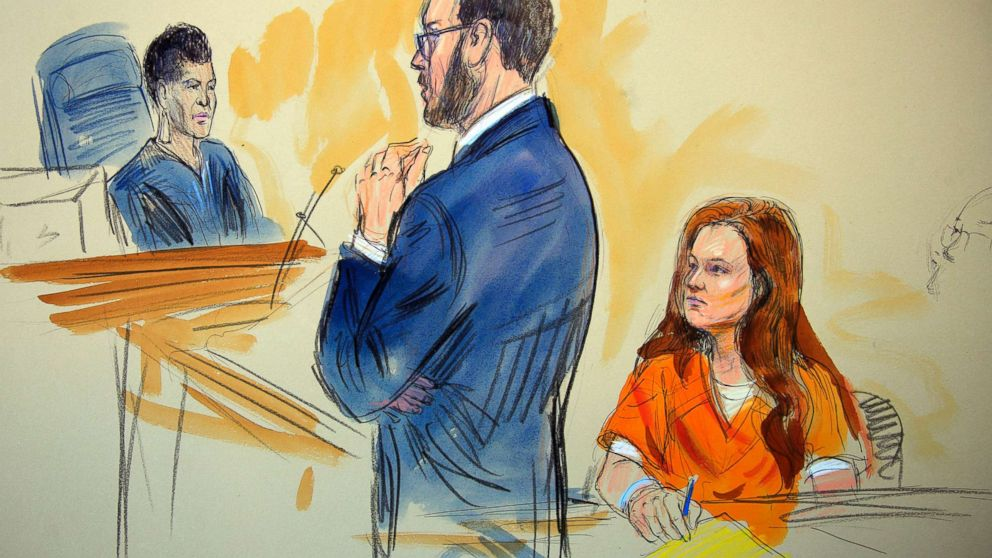 This courtroom sketch depicts Maria Butina listening to Assistant U.S. Attorney Erik Kenerson as he speaks to Judge Deborah Robinson, left, during a hearing in federal court in Washington, July 18, 2018.