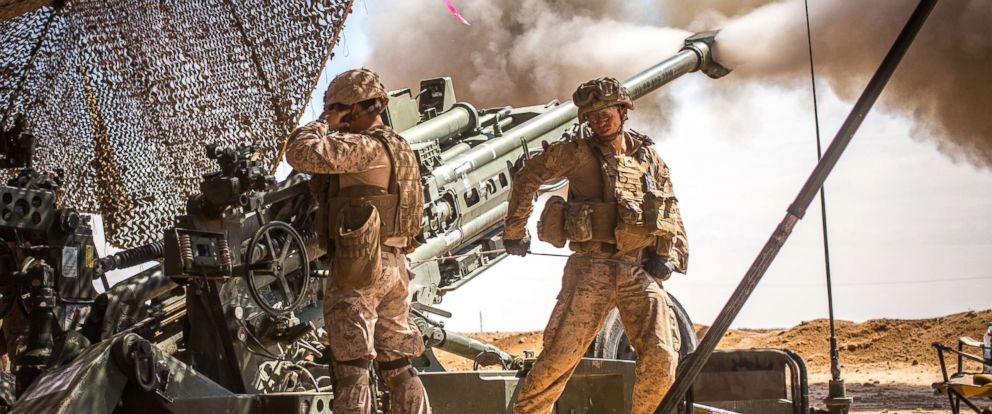 PHOTO: U.S. Marines with the 11th Marine Expeditionary Unit fire an M777 Howitzer during a fire mission in northern Syria as part of Operation Inherent Resolve, Mar. 24, 2017.