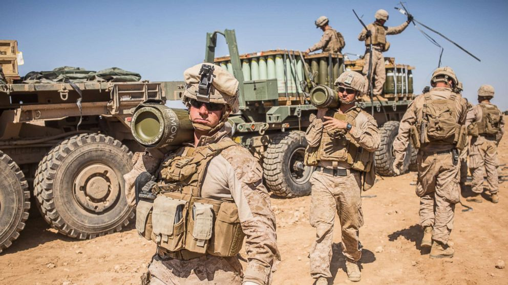 U.S. Marines with the 11th Marine Expeditionary Unit carry rounds to an M777 Howitzer gun line in preparation for fire missions in northern Syria as part of Combined Joint Task Force - Operation Inherent Resolve, Mar. 21, 2017.