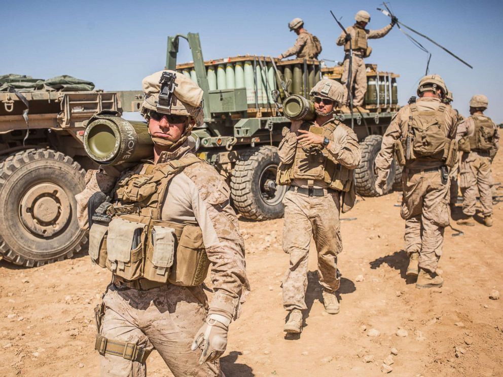 PHOTO: U.S. Marines with the 11th Marine Expeditionary Unit carry rounds to an M777 Howitzer gun line in preparation for fire missions in northern Syria as part of Combined Joint Task Force - Operation Inherent Resolve, Mar. 21, 2017.