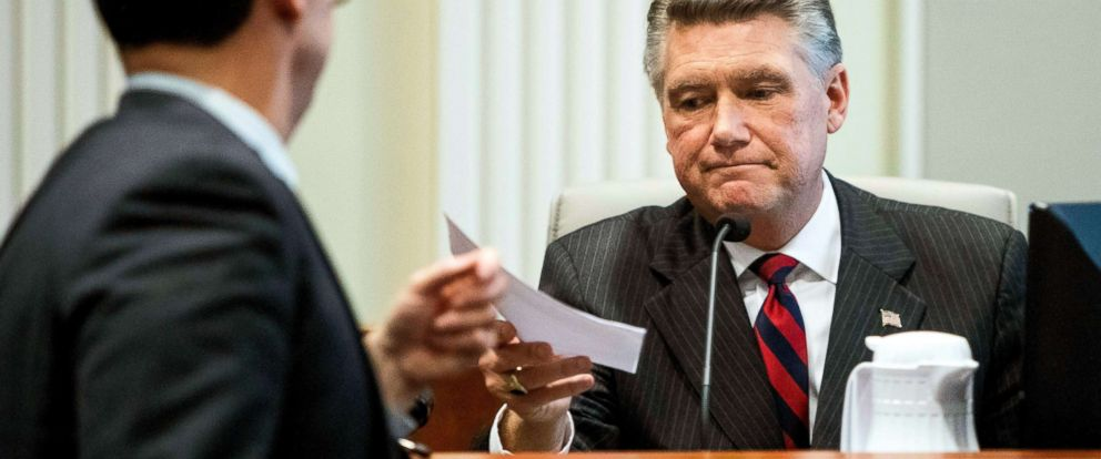 PHOTO: Mark Harris, Republican candidate in North Carolinas 9th congressional race, is handed a document during the fourth day of a public evidentiary hearing, Feb. 21, 2019, in Raleigh, N.C.