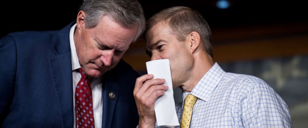 PHOTO: Rep. Mark Meadows, left, and Rep. Jim Jordan talk during the press conference calling on President Trump to declassify the Carter Page FISA applications, Sept. 6, 2018.
