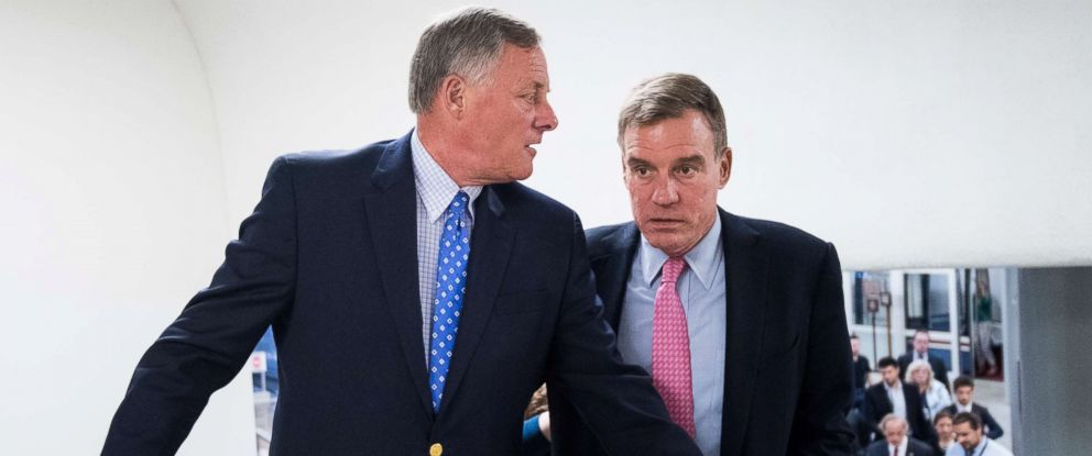 PHOTO: Sen. Richard Burr, left, speaks with Sen. Mark Warner as they arrive in the Capitol for a vote on Aug. 16, 2018 in Washington, D.C.