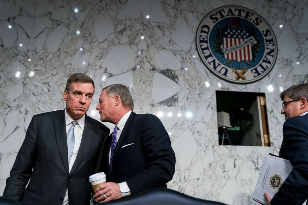PHOTO: Vice Chairman Mark Warner, D-Va., left, and Chairman Richard Burr, R-N.C., second from left, speak together following a Senate Select Committee on Intelligence hearing on worldwide threats, Feb. 13, 2018, in Washington.