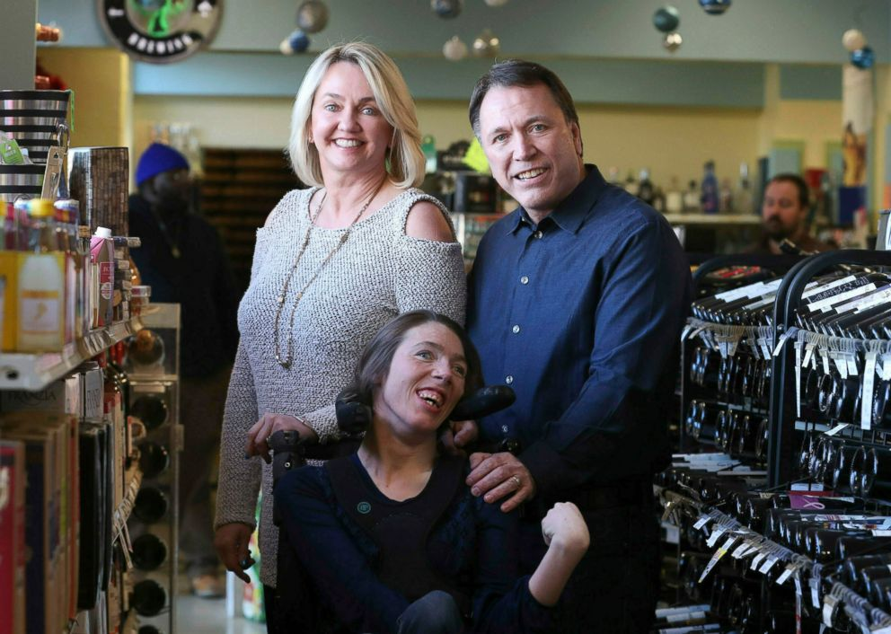 PHOTO: Doug Ketchum and his wife Mary pose with their daughter Stacie at their Memphis liquor store, Kimbrough Wine & Spirits.