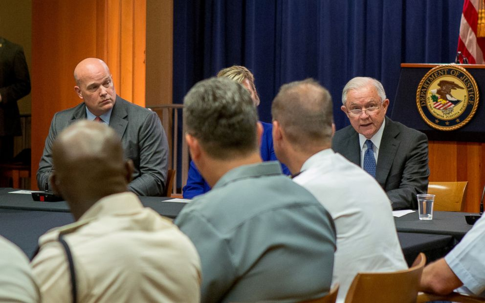 PHOTO: Matthew Whitaker looks over at Attorney General Jeff Sessions during a round table discussion with foreign liaison officers at the Justice Department in Washington, Aug. 29, 2018.