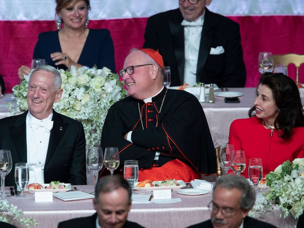 PHOTO: Former U.S. Secretary of Defense Jim Mattis, left, Cardinal Timothy Dolan, center, and Happy Warrior Award Recipient Mary Ann Tighe react to opening remarks during the 74th Annual Alfred E. Smith Dinner, Thursday, Oct. 17, 2019, in New York.