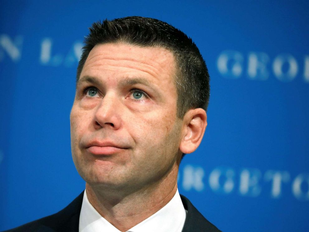 PHOTO: Acting Department of Homeland Security (DHS) Secretary Kevin McAleenan reacts while demonstrators interrupt his remarks at the Migration Policy Institute annual Immigration Law and Policy Conference in Washington D.C., Oct. 7, 2019.