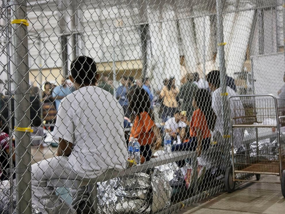 PHOTO: In this June 17, 2018, file photo, provided by U.S. Customs and Border Protection, people who have been taken into custody related to cases of illegal entry into the United States, sit in one of the cages at a facility in McAllen, Texas.