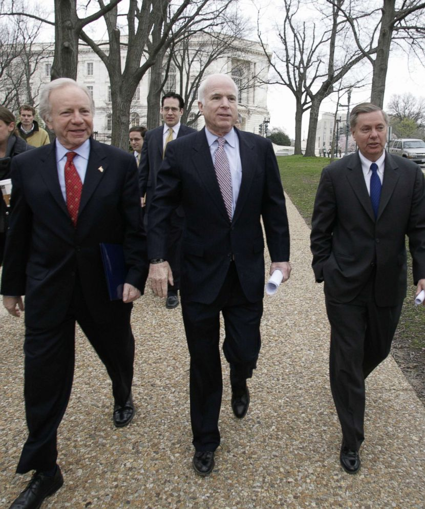 PHOTO: Senator John McCain (C) arrives with US Sen. Joe Lieberman (I-CT) and Sen. Lindsey Graham(R) R-SC at a Vets for Freedom rally on Capitol Hill, April 8, 2008.