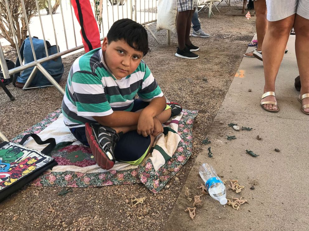PHOTO: Kassandra Morales took her 8-year-old son Mathew, pictured playing with toy soldiers while waiting in line, because she wanted to show her kids what a real hero is.
