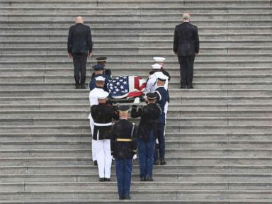 PHOTO: The casket of Senator John McCain arrives at the Capitol in Washington, on Aug. 31, 2018, as Cindy McCain and her sons John Sidney McCain and James McCain look on.