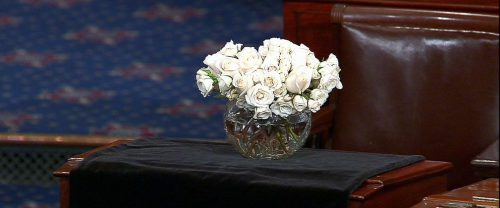 PHOTO: Sen. John McCains seat draped with a black sheet and white flowers from the Senate floor at the Capitol, Aug