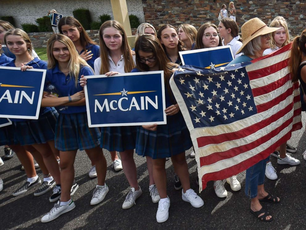 PHOTO: People gather along the street after the memorial service for the late Senator John McCain at the North Phoenix Baptist Church, Aug. 30, 2018, in Phoenix.