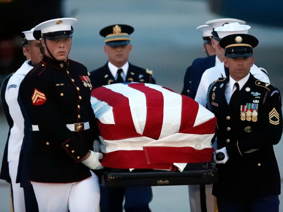 The flag-draped casket of Sen. John McCain, R-Ariz., is carried by an Armed Forces body bearer team to a hearse, Thursday, Aug. 30, 2018, at Andrews Air Force Base, Md.
