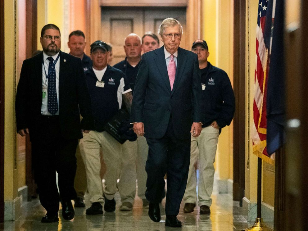 PHOTO: Senate Majority Leader Mitch McConnell walks with Sept. 11 first responders John Feal, second from left, Ret. Lt. Michael OConnell, back right, and other first responders, following their meeting on Capitol Hill in Washington, June 25, 2019.