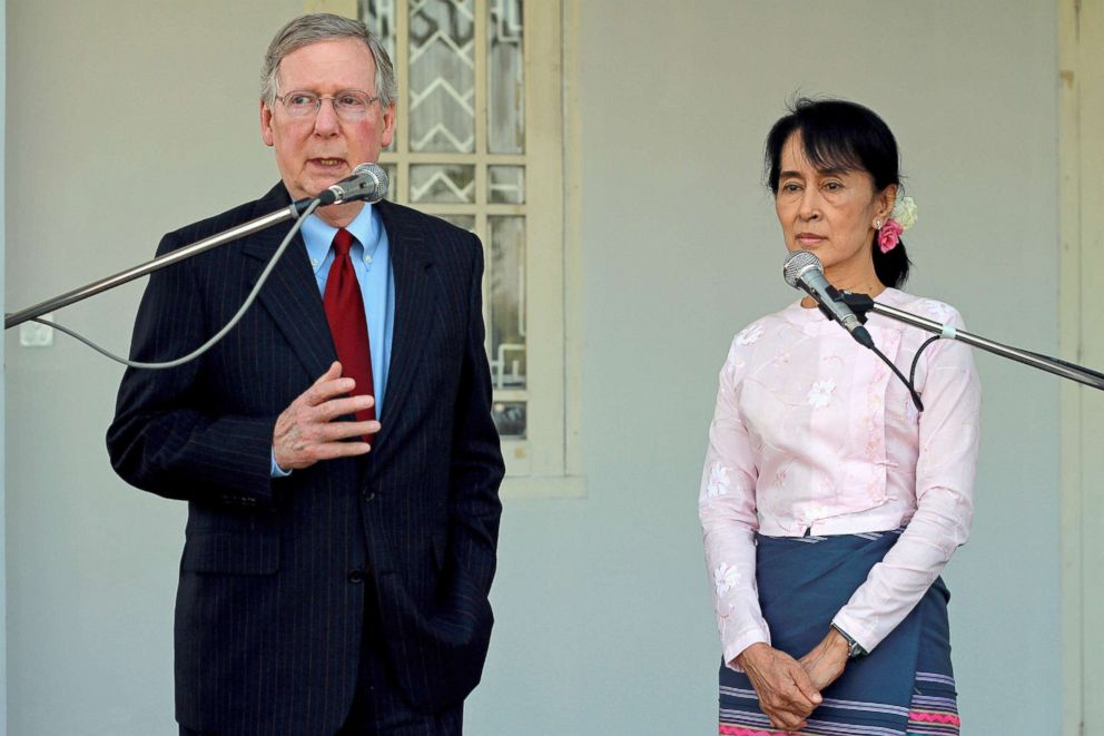 PHOTO: Senator Mitch McConnell addresses reporters following a meeting with Aung San Suu Kyi, right, at her residence in Yangon, Myanmar, Jan. 16, 2012.