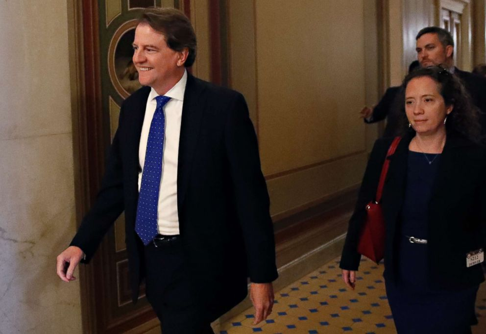 PHOTO: White House Counsel Don McGahn smiles ahead of a Senate vote to advance Brett Kavanaughs nomination to the Supreme Court, on Capitol Hill, Oct. 5, 2018, in Washington.
