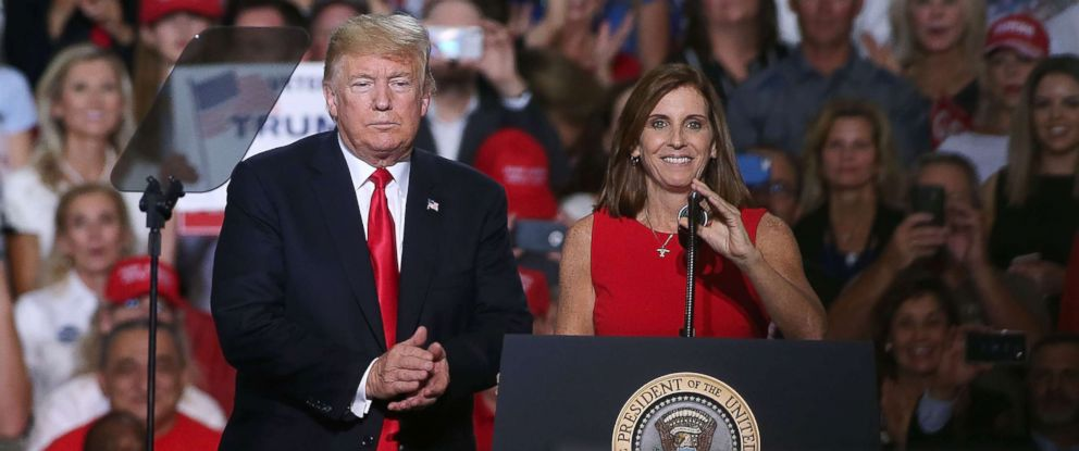 PHOTO: President Donald Trump welcomes Rep. Martha McSally, R-Ariz, to the stage during a rally at the International Air Response facility, Oct. 19, 2018, in Mesa, Ariz.