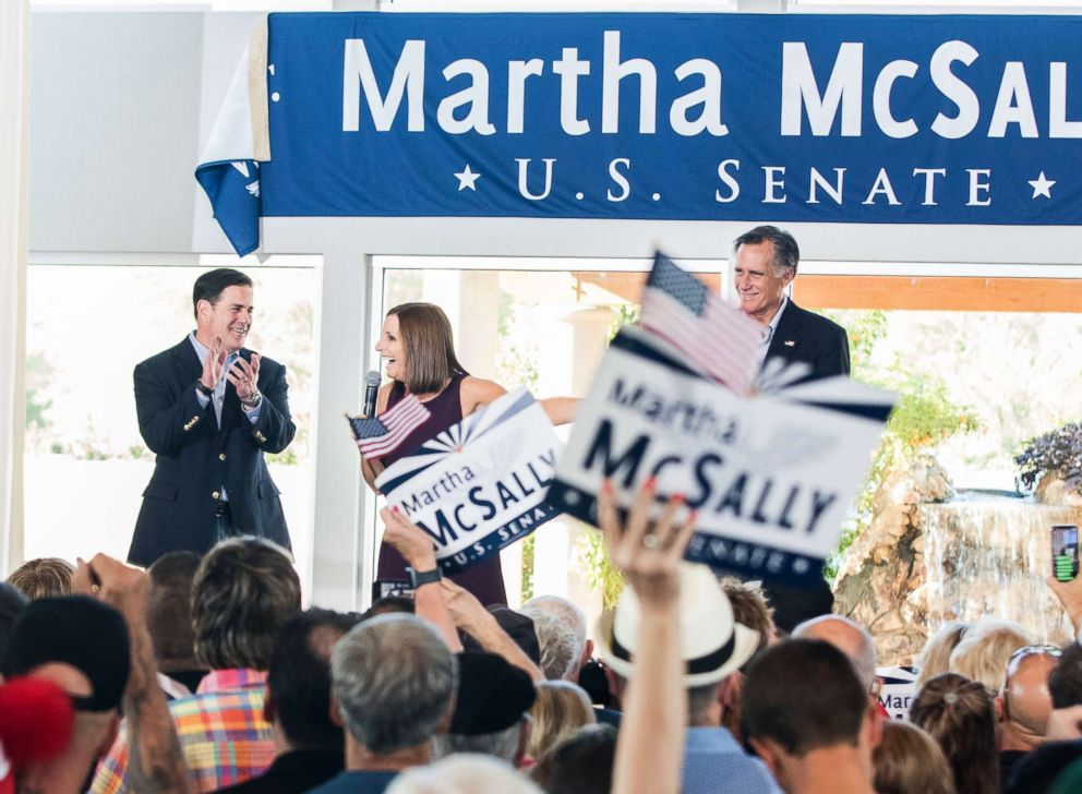 PHOTO: U.S. Rep. Martha McSally address her constituents along with Arizona Governor Doug Ducey, left, and Republican presidential nominee Mitt Romney, right, during a Get Out the Vote Rally, Oct. 12, 2018, in Gilbert, Ariz.