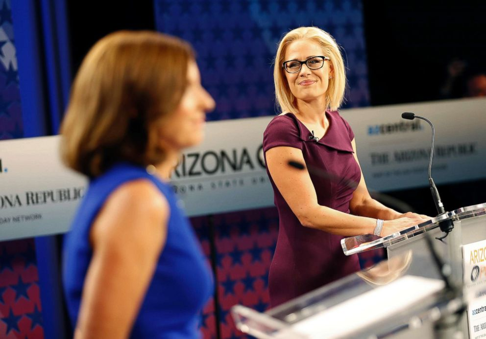 PHOTO: U.S. Senate candidates, Rep. Martha McSally and Rep. Kyrsten Sinema prepare their remarks prior to a televised debate, Oct. 15, 2018, in Phoenix.