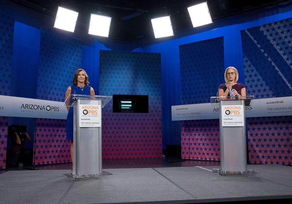 PHOTO: Republican Senate candidate Martha McSally and Democratic Senate candidate Kyrsten Sinema prepare to debate at the studios of a public television station in Phoenix, Oct. 15, 2018.