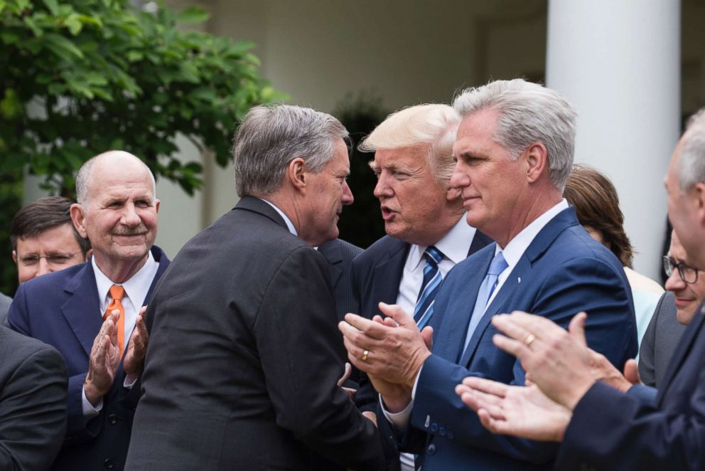 PHOTO: Rep. Mark Meadows shakes hands with President Trump, at the press conference with members of the GOP, on the passage of legislation to roll back the Affordable Care Act, in the Rose Garden of the White House, May 4, 2017.