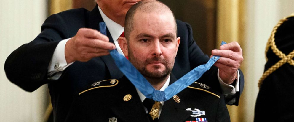 PHOTO: President Donald Trump presents the Congressional Medal of Honor to former Army Staff Sgt. Ronald J. Shurer II for actions in Afghanistan, in the East Room of the White House, Oct. 1, 2018, in Washington.