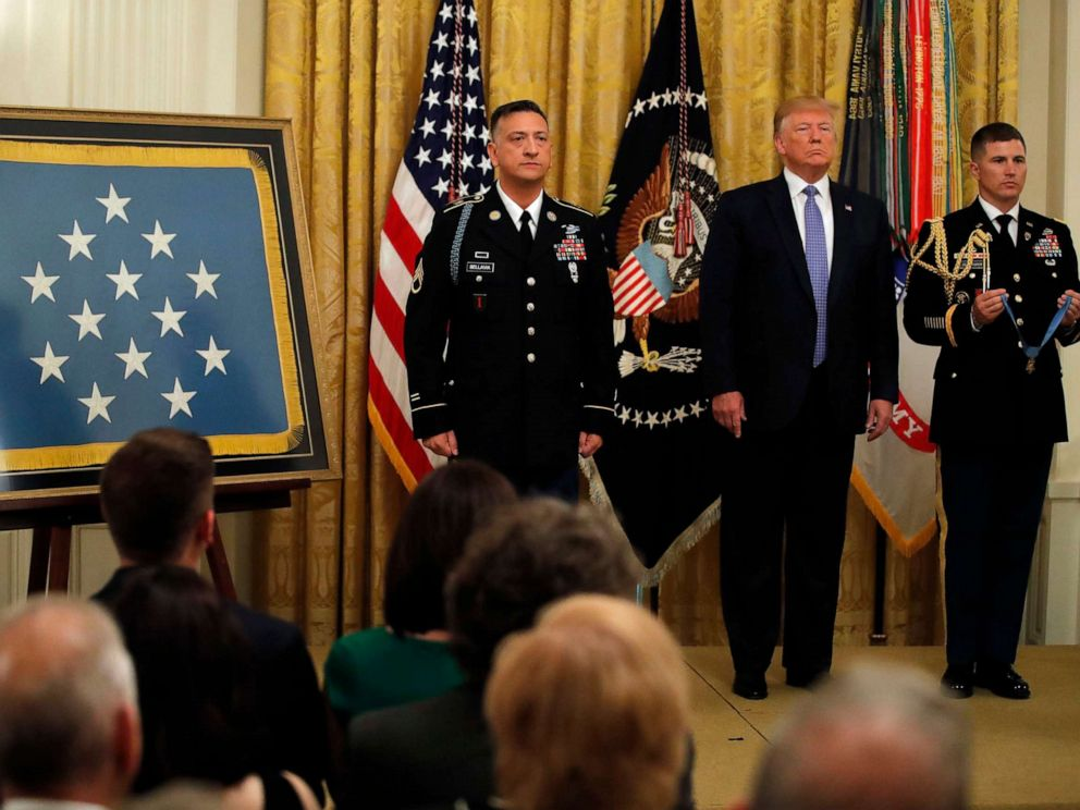 PHOTO: President Donald Trump stands with Army Staff Sgt. David Bellavia, left, as the citation is read before Bellavia was awarded the Medal of Honor at the White House on June 25, 2019.