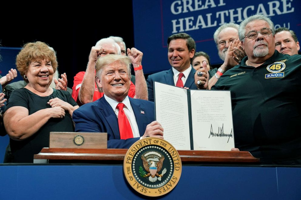 PHOTO: President Donald Trump holds up an executive order on Medicare he signed during an event at The Villages retirement community in The Villages, Florida, Oct. 3, 2019.