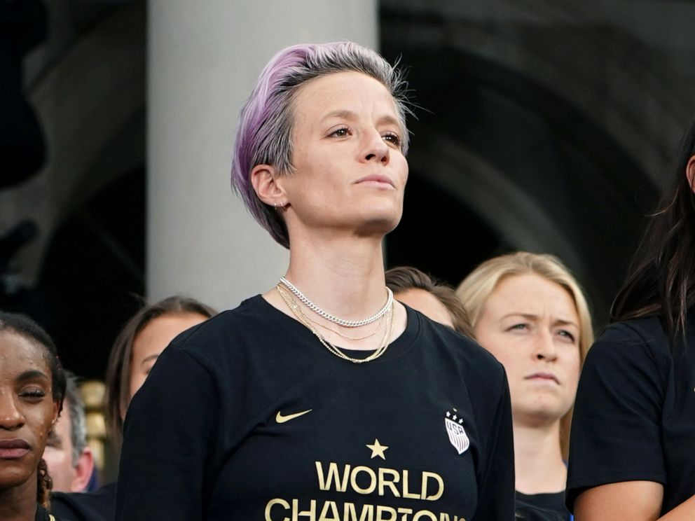 PHOTO: Megan Rapinoe and Alex Morgan of the U.S. stand during the national anthem at the Womens World Cup Champions Parade in New York City, July 10, 2019.