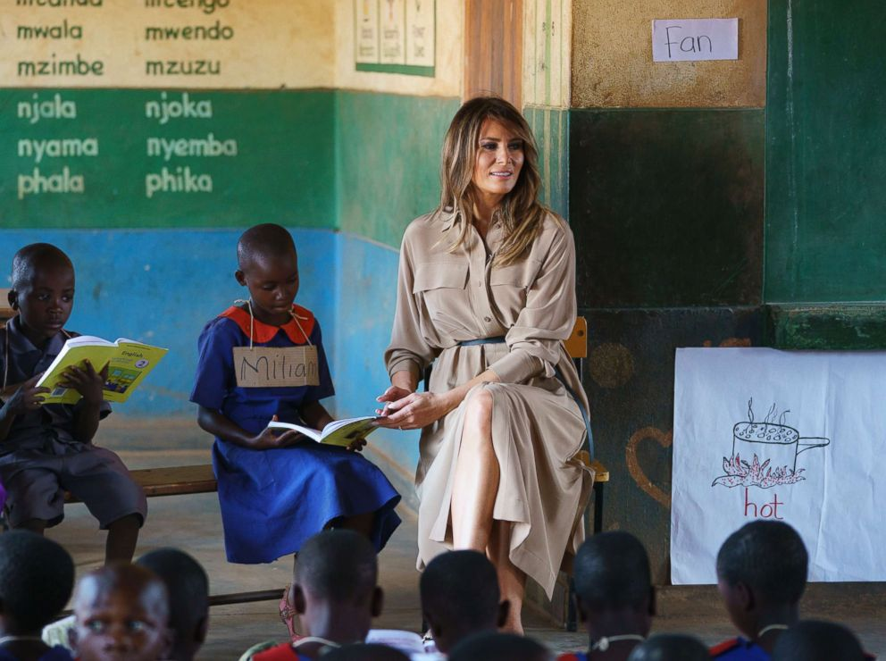 PHOTO: First lady Melania Trump helps a student as she visits a language class at Chipala Primary School, in Lilongwe, Malawi, Oct. 4, 2018.