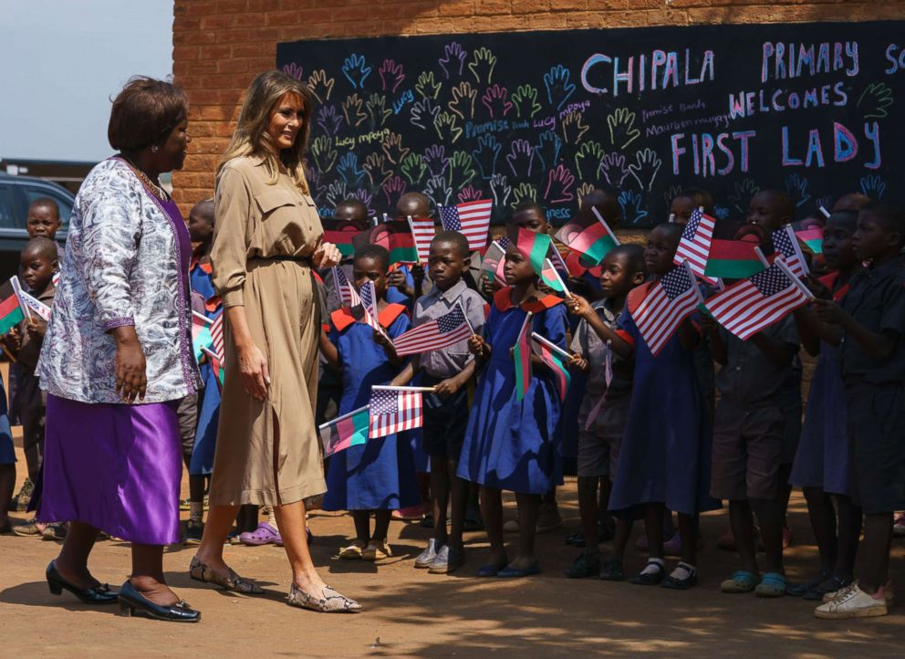 First lady Melania Trump is escorted by head teacher Maureen Masi as she arrives for a visit to Chipala Primary School, in Lilongwe, Malawi, Oct. 4, 2018.