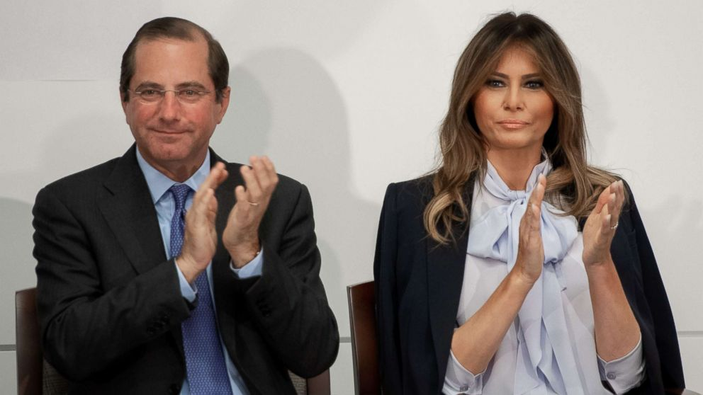 First Lady Melania Trump applauds as she arrives alongside US Secretary of Health and Human Services Alex Azar, left, during the Federal Partners in Bullying Prevention (FPBP) Cyberbullying Prevention Summit at the US Health Resources and Services Administration building in Rockville, Maryland, Aug. 20, 2018.