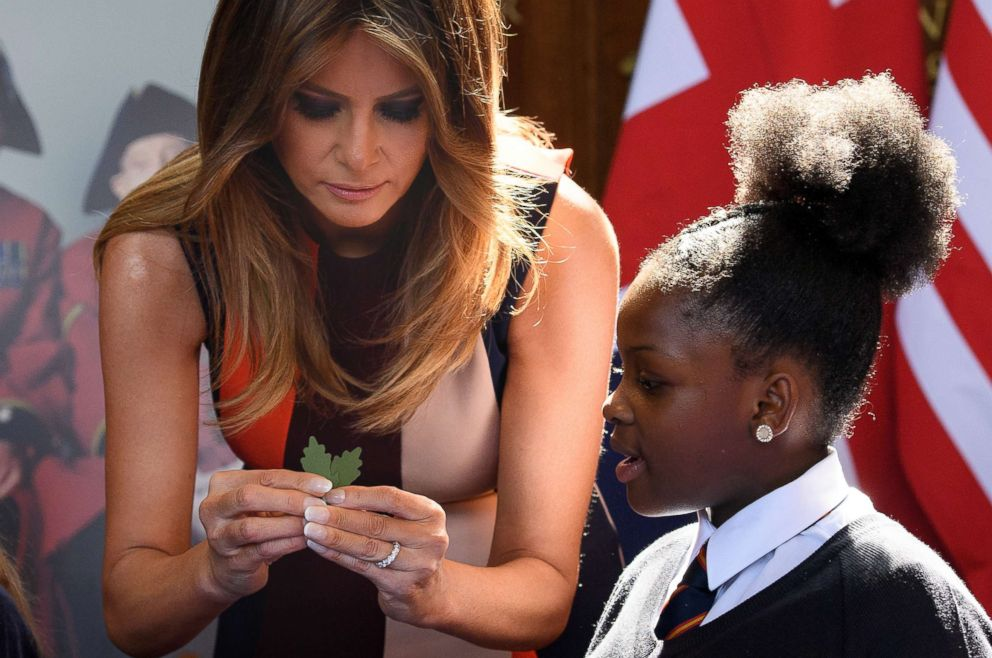 PHOTO: First lady Melania Trump makes Remembrance Day poppies with schoolchildren and British Army veterans, known as Chelsea Pensioners, at Royal Hospital Chelsea on July 13, 2018 in London.