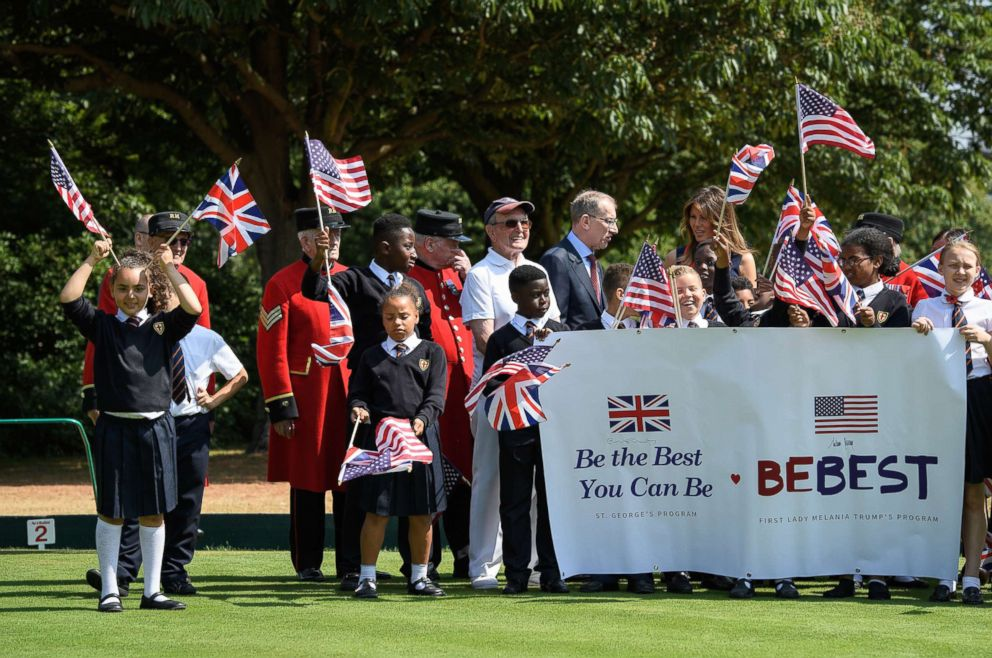 PHOTO: First lady Melania Trump stands with school children as she meets British Army veterans at Royal Hospital Chelsea on July 13, 2018 in London.
