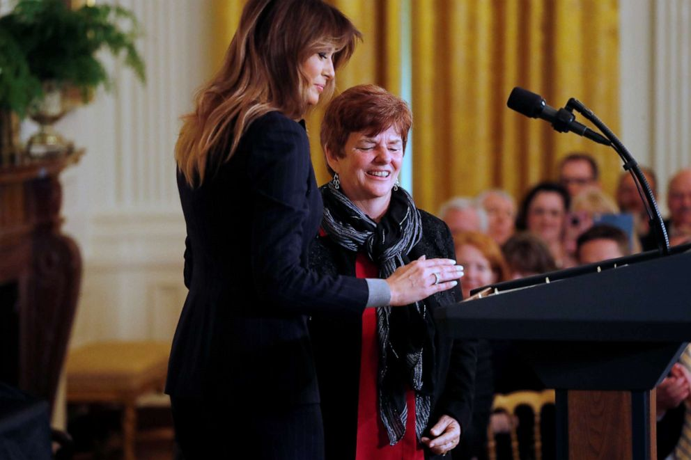 PHOTO: First lady Melania Trump brings Betty Henderson, who wrote to the first lady after her son died from an opioid overdose, to the stage as she addresses an opioid crisis summit at the White House in Washington, March 1, 2018.