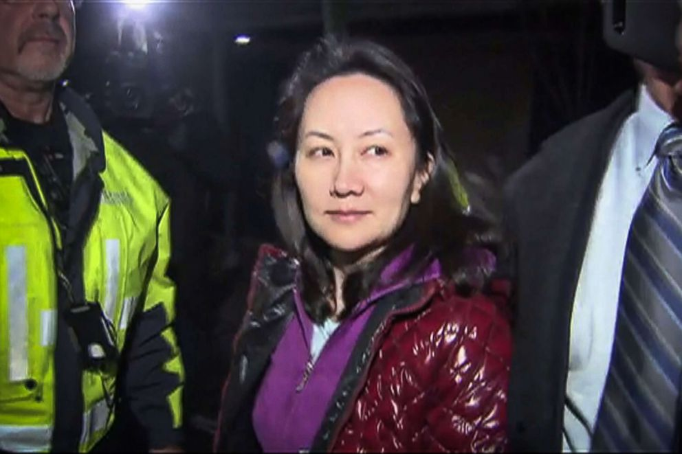 PHOTO: This TV image provided by CTV to AFP shows Huawei Technologies Chief Financial Officer Meng Wanzhou as she exits the court registry following the bail hearing at British Columbia Superior Courts in Vancouver, British Columbia, Dec. 11, 2018.