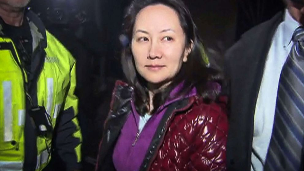 This TV image provided by CTV to AFP shows Huawei Technologies Chief Financial Officer Meng Wanzhou as she exits the court registry following the bail hearing at British Columbia Superior Courts in Vancouver, British Columbia, Dec. 11, 2018.