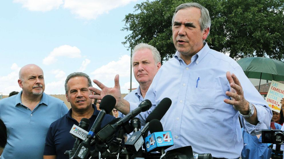 Sen. Jeff Merkley, right, D-Ore., speaks to the media along with Sen. Chris Van Hollen, center, D-Md., in front of the U.S. Customs and Border Protection's Rio Grande Valley Sector's Centralized Processing Center in McAllen, Texas, on June 17, 2018.