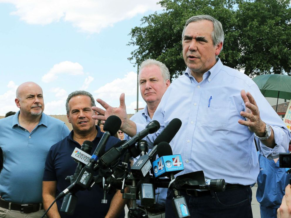 PHOTO: Sen. Jeff Merkley, right, D-Ore., speaks to the media along with Sen. Chris Van Hollen, center, D-Md., in front of the U.S. Customs and Border Protections Rio Grande Valley Sectors Centralized Processing Center in McAllen, Texas, June 17, 2018.