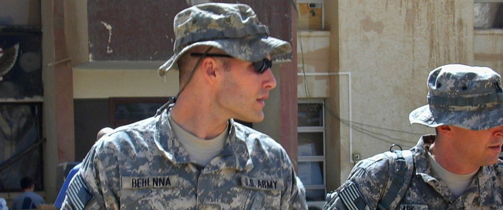 PHOTO: 1st Lt. Michael C. Behenna, left, and his defense attorney Capt. Tom Clark, right, walk in Camp Speicher north of Baghdad, Iraq, Sept. 21, 2008.