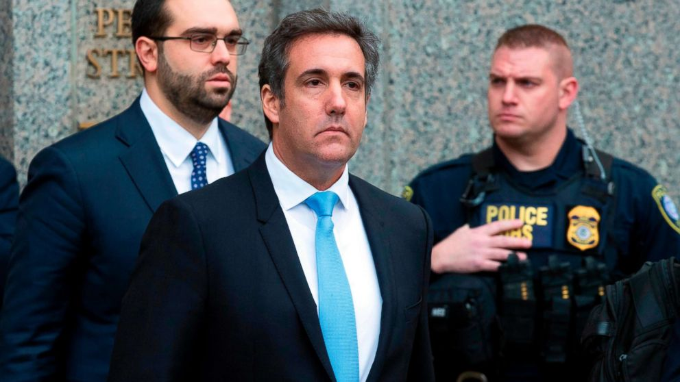 Michael Cohen, President Donald Trump's personal attorney, center, leaves federal court, in New York, April 16, 2018.